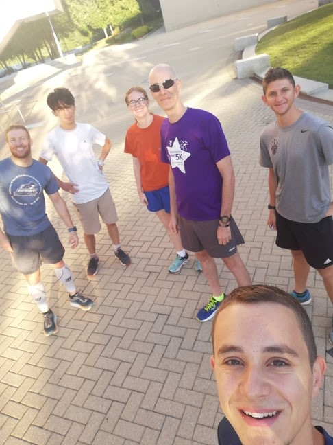 A group selfie of people ready to go for a run.